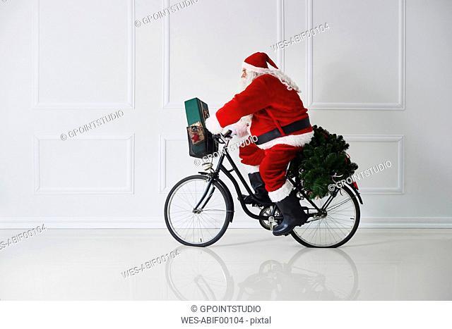 Santa Claus riding bicycle