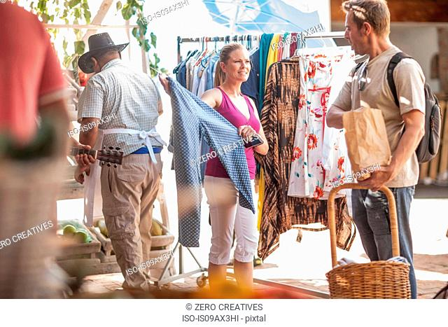 Tourists browsing in market