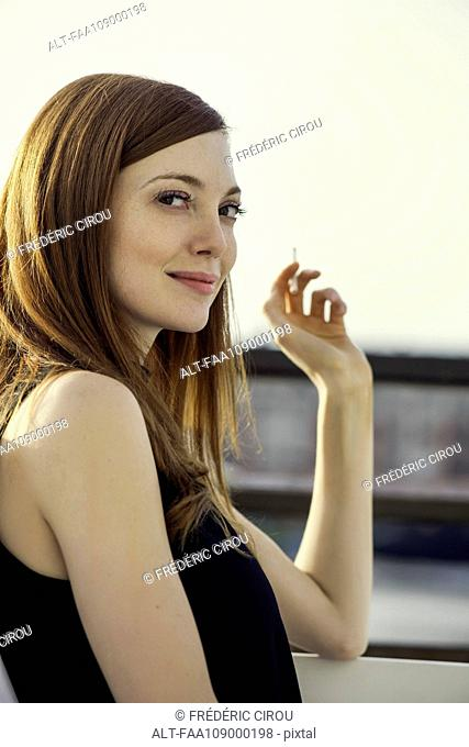 Woman smoking, portrait