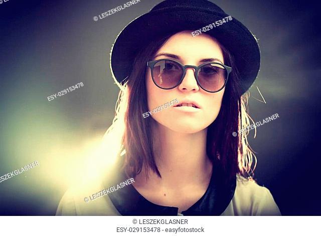 Retro fashion portrait of fashionable stylish young woman