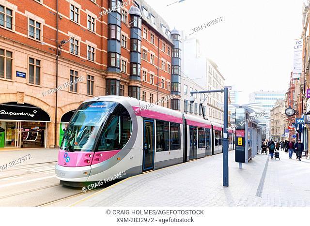 A tram in Birmingham City Centre, England. Corporation Street