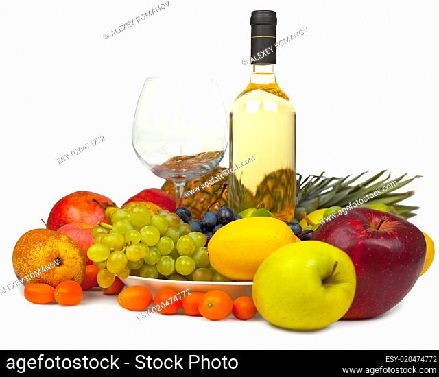Still-life from wine and fruits on white background