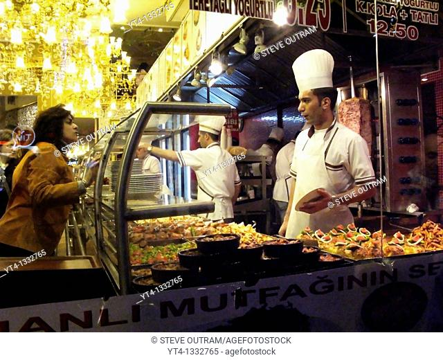 The city that never sleeps  Choosing Food at a Istiklal Street Restaurant Counter, Beyoglu, Istanbul, Turkey