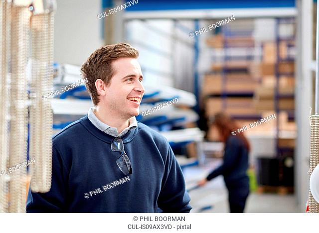 Mid adult male worker in manufacturing factory