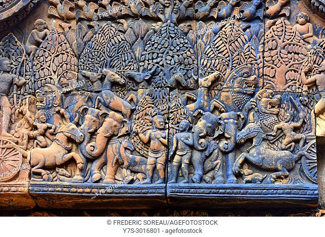 Bas relief carvings in red sandstone at Banteay Srei, a 10 th century temple to Hinduism, Cambodia, South East Asia, Asia