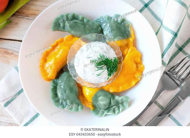 Vareniki called also dumplings, varenyky. Traditional Ukrainian cuisine (food). On old wooden white background