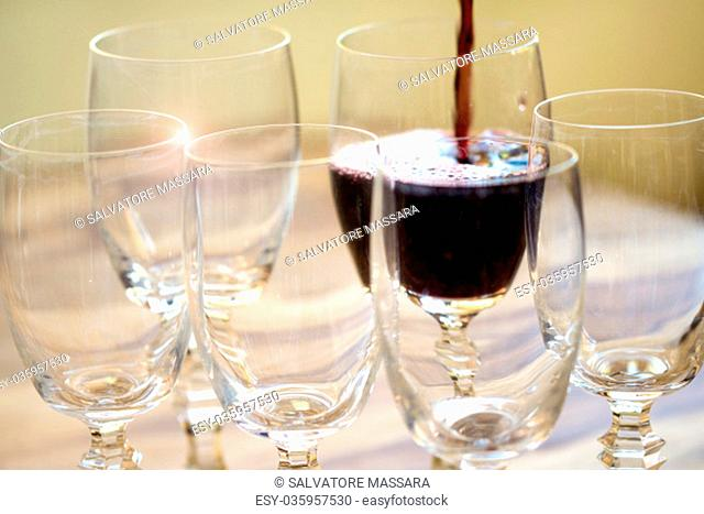 pouring red wine in the crystal flute