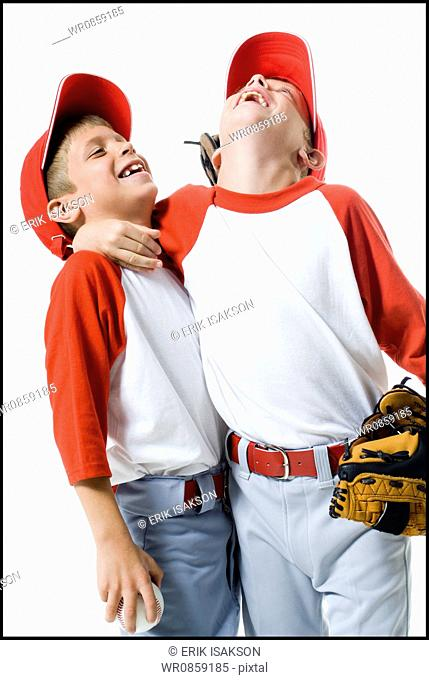 Close-up of two baseball players smiling