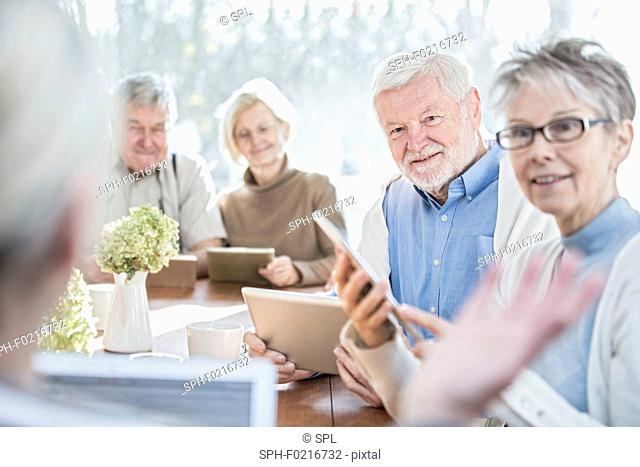 Seniors with tablets