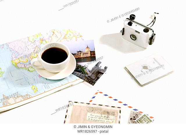 A cup of coffee on a map