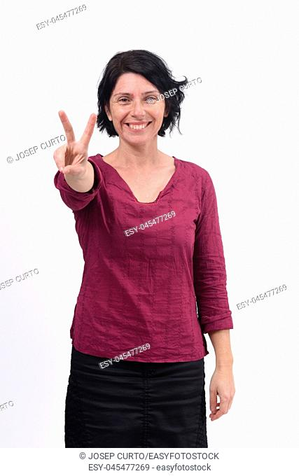 woman making the victory sign on a white background