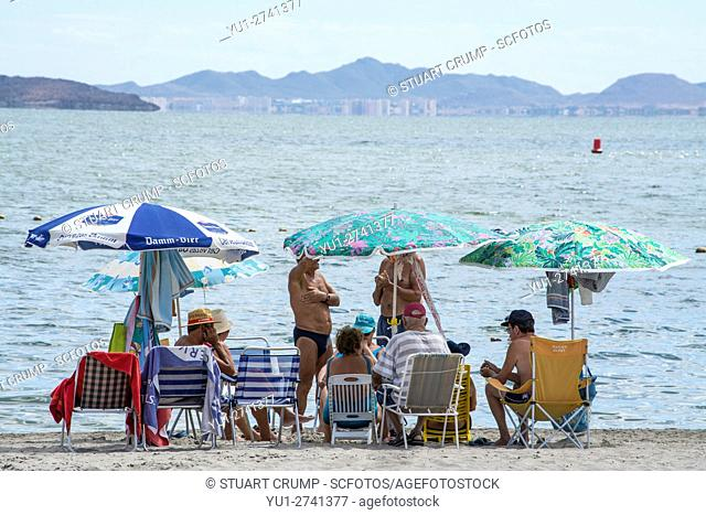 Tourists and locals on the beach at Los Alcazares by the Mar Menor in the region of Murcia, Costa Calida, Spain