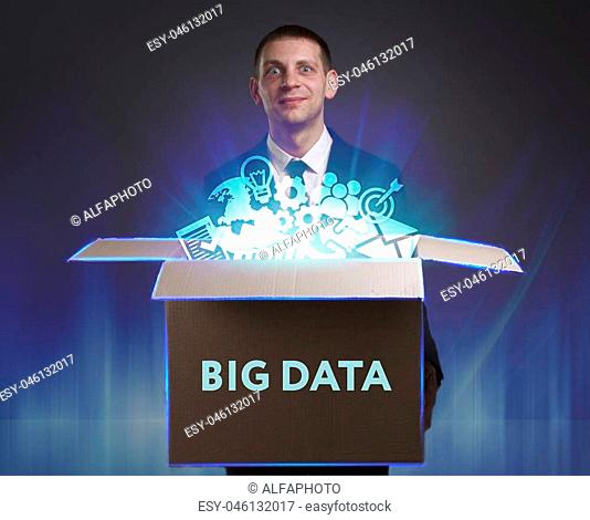 Business, Technology, Internet and network concept. Young businessman shows the word: Big data