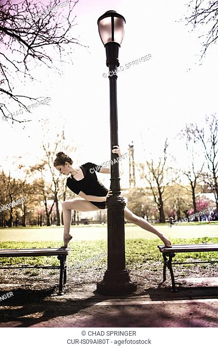 Modern dancer striking a pose in a urban park