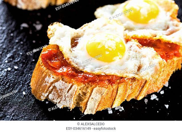 Typical spanish food tapas: Quail eggs and sobrada of Mallorca