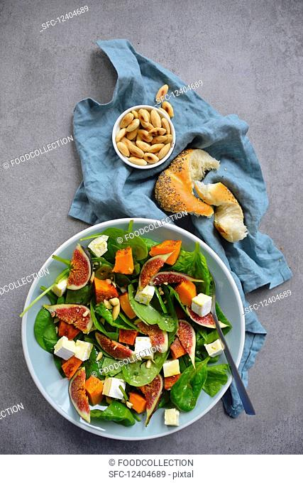 Salad with spinach figs baked pumpkin and almonds
