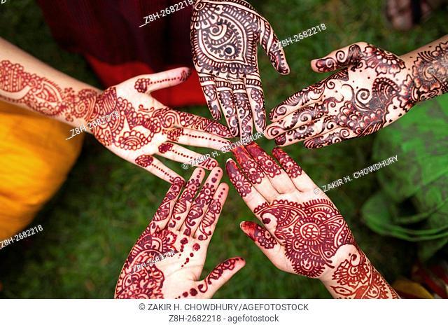DHAKA, BANGLADESH - JUNE 11 : Bangladeshi girl shows her hand, decorated with henna during the Mehendi Festival (Henna Festival) a festival ahead of Ramadan in...