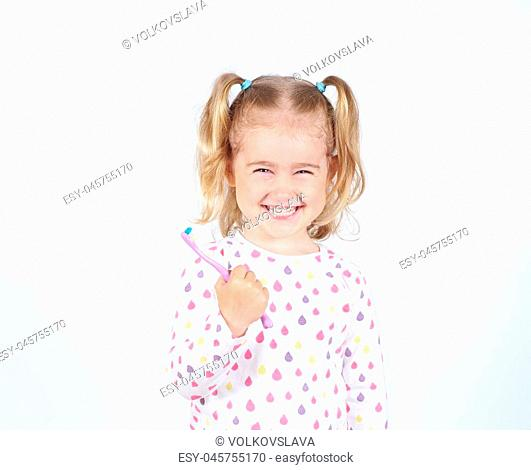 Little girl brushing her teeth. Girl with a toothbrush. Oral hygiene