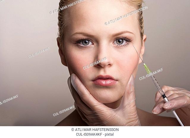 Teenage girl having neurotoxin injection