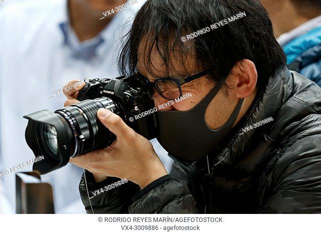March 3, 2018, Yokohama, Japan - A man tries out an Olympus camera at the CP+ Camera & Photo Imaging Show 2018 in Pacifico Yokohama
