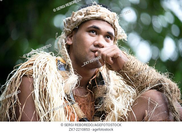 Rarotonga Island. Cook Island. Polynesia. South Pacific Ocean. A man with clothes of Maori hunter in Highland Paradise Cultural Village show