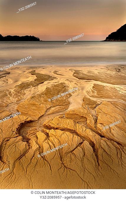 Alenglow after sunset, low tide erosion in sand, Anchorage Bay, Abel Tasman National Park