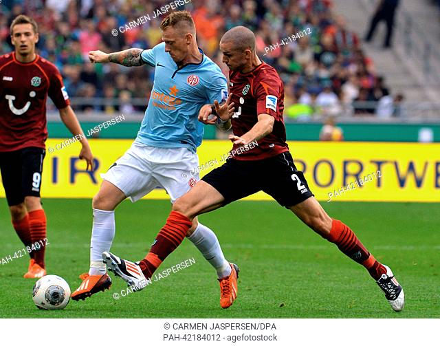 Hanover's Leon Andreasen (R) vies for the ball with Mainz' Niki Zimling during the Bundesliga soccer match between Hannover 96 vs