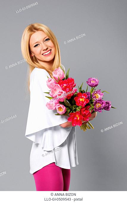 Smiling blonde woman with spring flower Debica, Poland