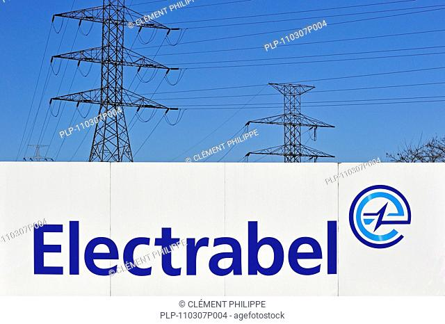 Electricity pylons and sign of energy corporation Electrabel, Ghent, Belgium