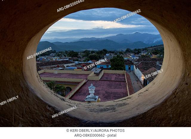 Town seen from behind round window of bell tower, Trinidad, Cuba