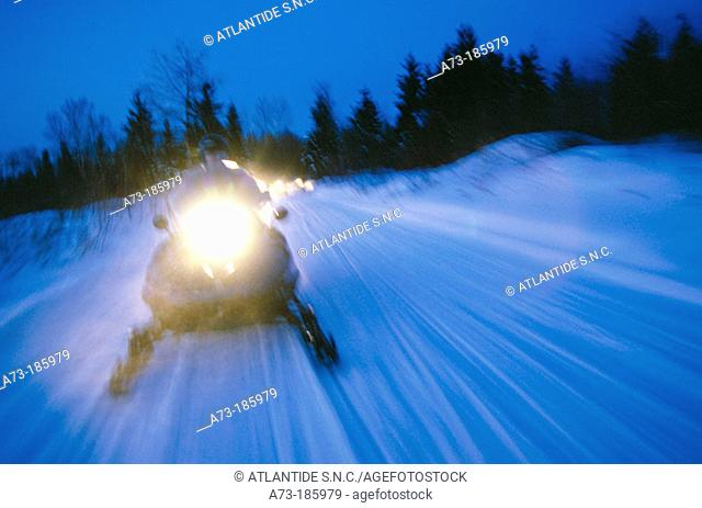 Snowmobile at night. Quebec. Canada