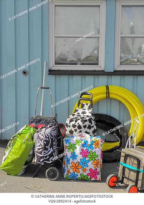 Brightly coloured luggage on the quayside waiting to board the ferry near Gothenburg, Sweden