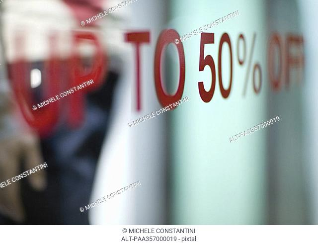 'Up to 50 off' text on shop window