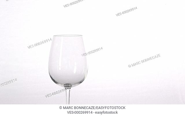 white wine flowing into glass
