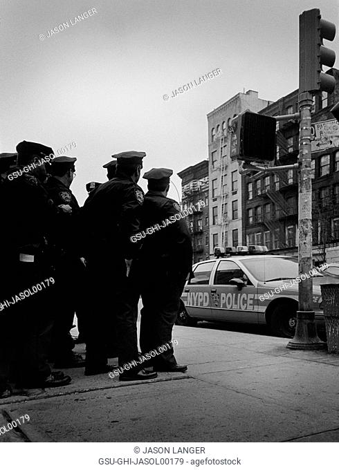 Group of Police Officers Standing on Street Corner, New York City, New York, USA