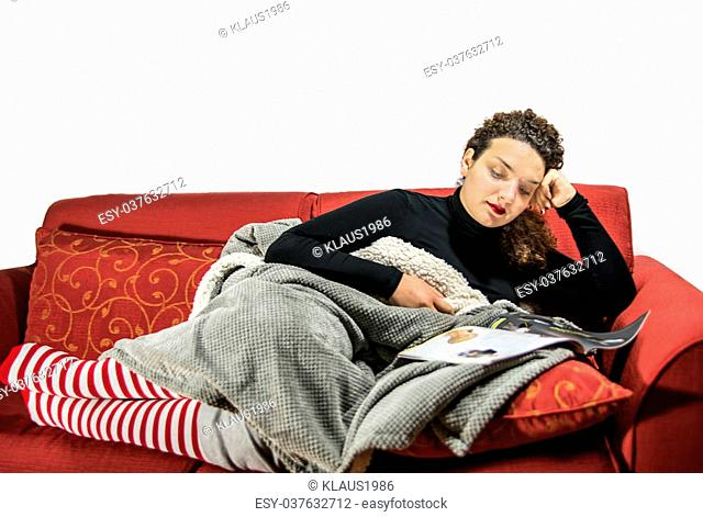 Beautiful girl relaxing on the sofà with christmas socks