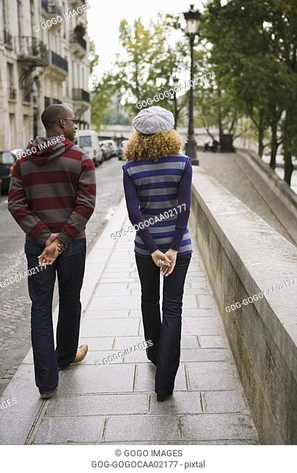 Rear view of African couple walking