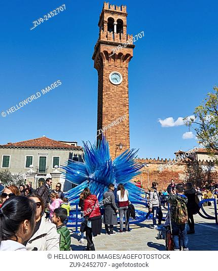 Tourists at the clock tower and blue glass sculpture in Campo Santo Stefano, Murano, Venetian Lagoon, Veneto, Italy, Europe