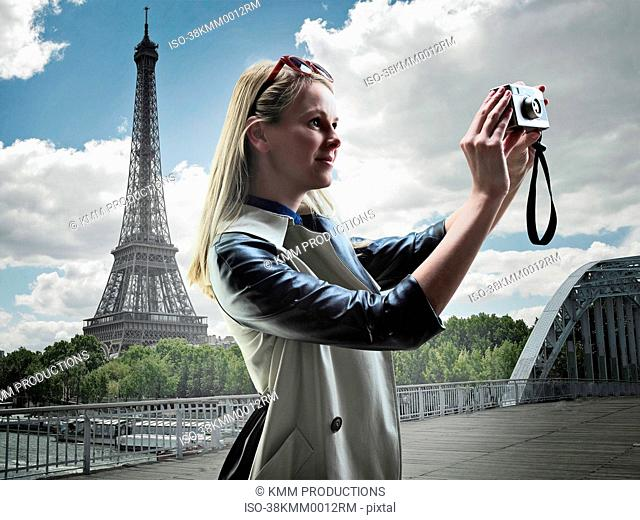 Woman taking pictures in Paris