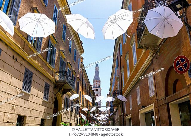 Italy, Emilia Romagna, Modena, hanged umbrella, cathedral belfry in background