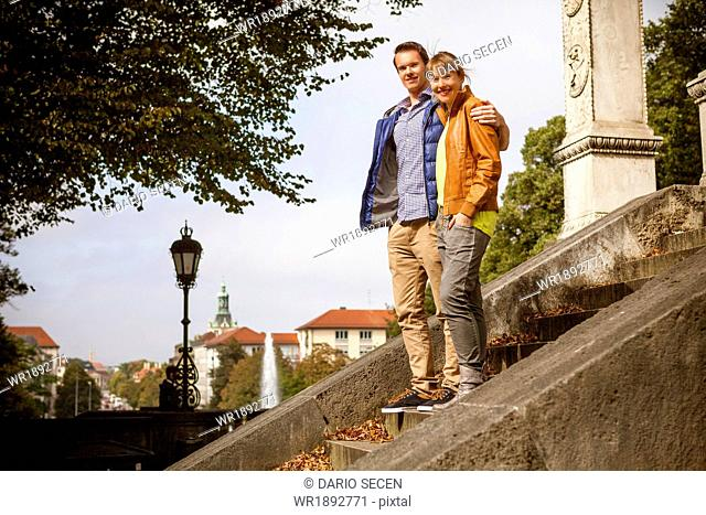 Young couple by Angel of Peace Monument, Munich, Bavaria, Germany