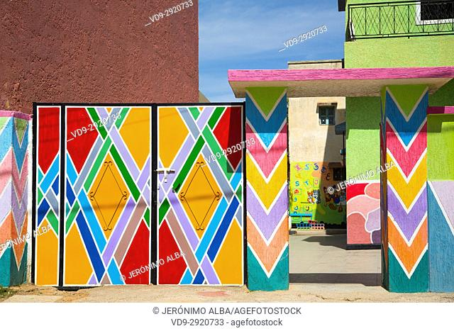 Bhalil, colored entrance door to a school. Morocco, Maghreb North Africa