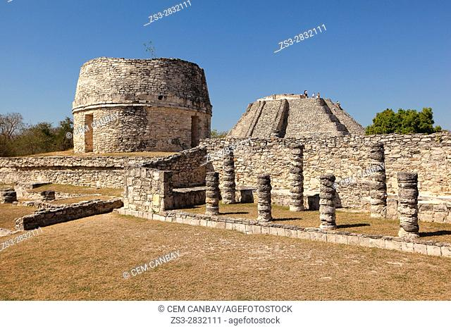View to the Templo Redondo-Round Temple and visitors climbing up to the Castle of Kukulcan-Castillo de Kukulcan in Mayapan Archeological site, Merida