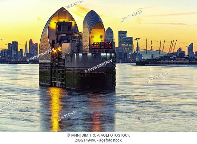 Thames Barrier at night,Canary Wharf and The Millennium Dome at night,London,England