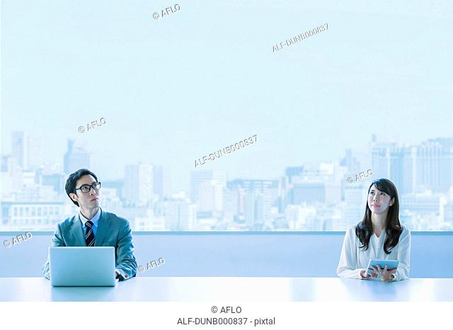 Japanese businesspeople in a modern office