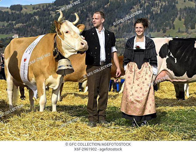 Simmental cow Marina as winner of the Miss Simmental title and her proud owner, SWISSCOW Topschau Saanenland, Gstaad, Switzerland