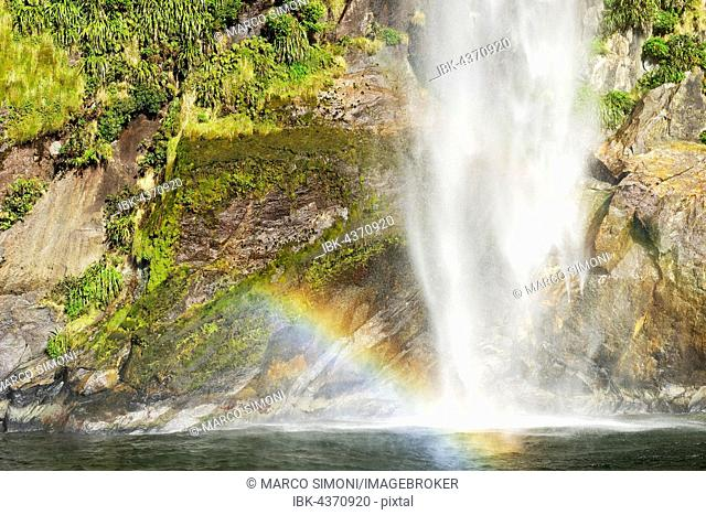 Rainbow over waterfall, Milford Sound, Fiordland National Park, South Island, New Zealand