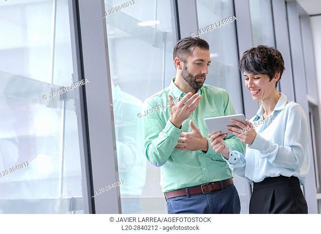 Executive couple with tablet, Donostia, San Sebastian, Gipuzkoa, Basque Country, Spain