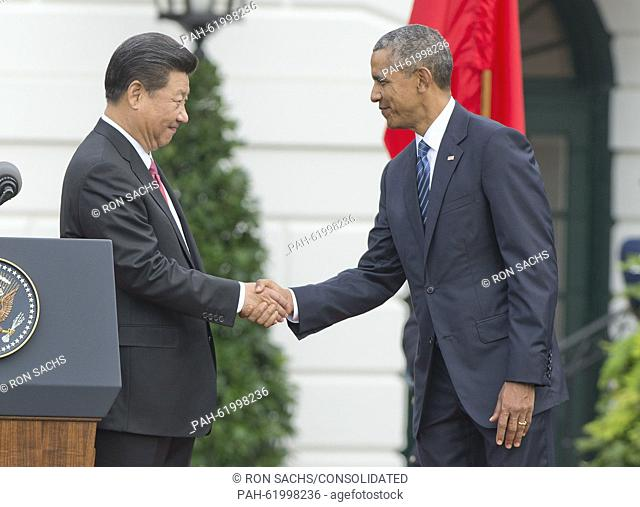 United States President Barack Obama and President XI Jinping of China shake hands after the President concluded his remarks welcoming the Chinese leader during...