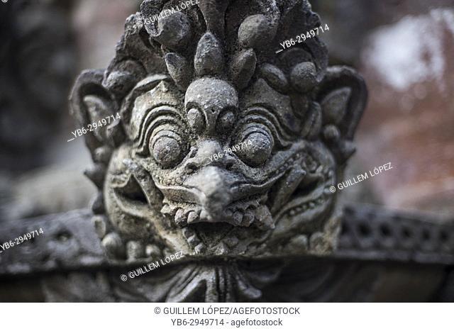 Stone gargoyle at the tirta empul temple of Ubud, Bali, Indonesia